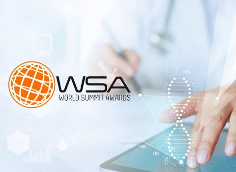 Mão num tablet World Summit Awards